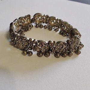 Cosmetic   Silver elastic bracelet, Dangle